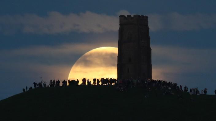 Strawberry Moon Rises Over Glastonbury Tor