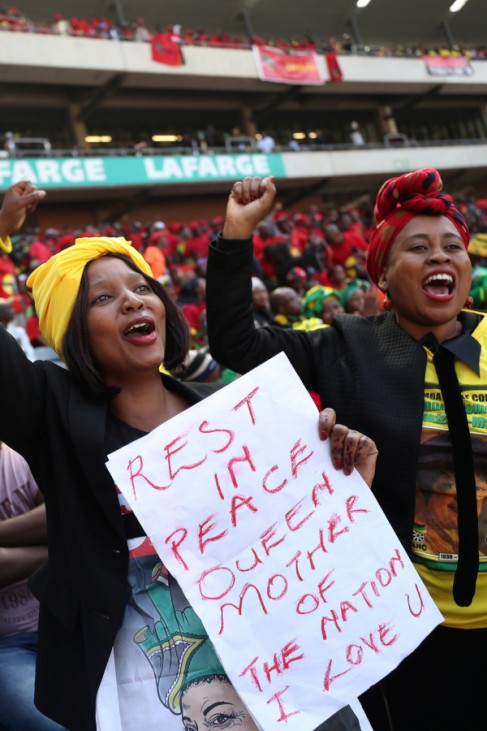 Women cheer during eulogies at Winnie Madikizela-Mandela's funeral in Orlando stadium in Soweto