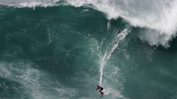 Spanish big wave surfer Axi Muniain drops in on a large wave at Praia do Norte in Nazare