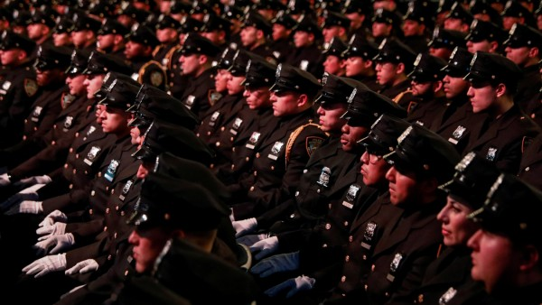 New York City Police (NYPD) officers sit during their graduation ceremony at Madison Square Garden in New York