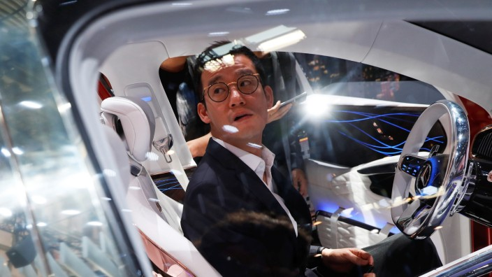 People check Mercedes-Maybach Ultimate Luxury displayed during a media preview of the Auto China 2018 motor show in Beijing