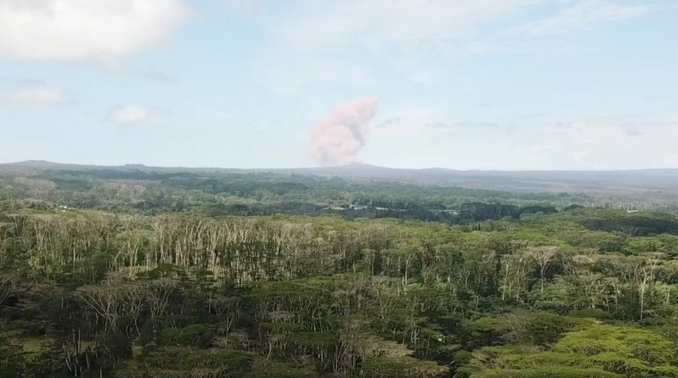 An ash cloud rises above Kilauea Volcano after it erupted, on Hawaii's Big Island