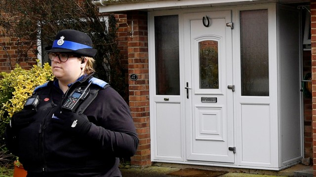 A police officer stands guard outside of the home of former Russian military intelligence officer Sergei Skripal, in Salisbury