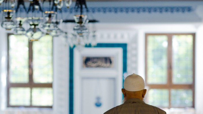 Muslim man stands in Sehitlik Mosque during open house day in Berlin