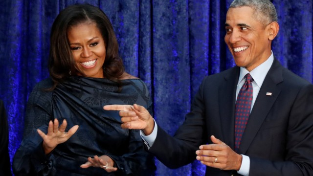 FILE PHOTO: Former U.S. President Obama and first lady Michelle Obama acknowledge guests during  portraits unveiling at the SmithsonianâÄÖs National Portrait Gallery in Washington