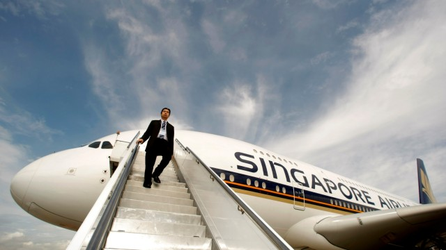FILE PHOTO: Singapore Airlines staff member walks down a set of stairs from an Airbus A380 in Sydney