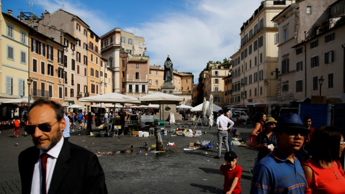 People walk in Campo dei Fiori square in Rome