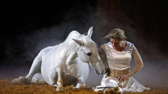 A dancer and horse perform during the show 'Apassionata' in Lisbon