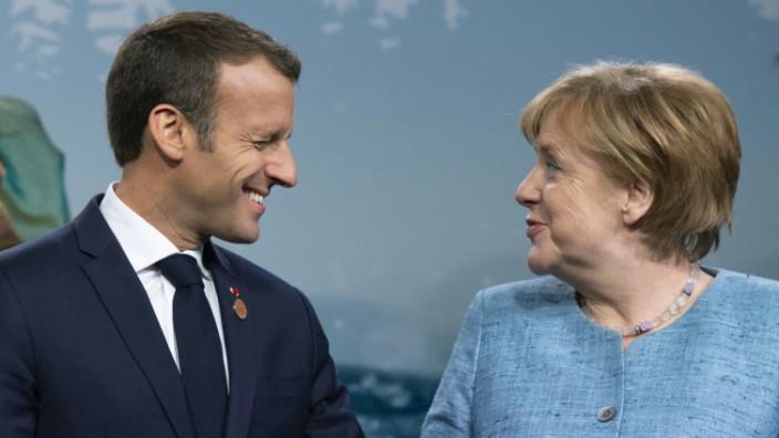 Macron, Merkel