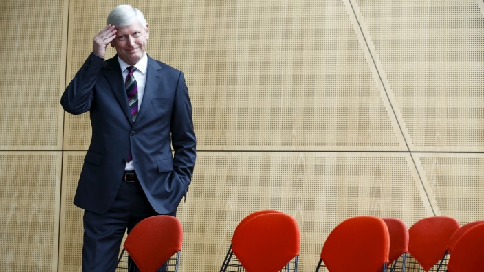 RWE deputy CEO Schmitz is pictured at the annual financial results news conference in Essen