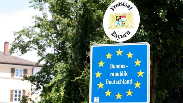 Traffic sign is seen between Kiefersfelden and Austrian city Kufstein