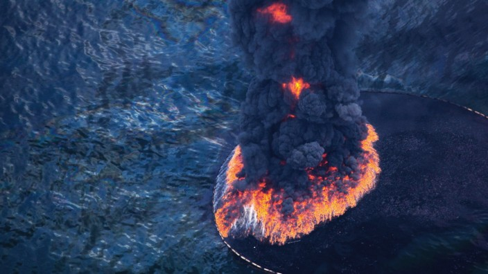 Fire and smoke rise from a controlled burn of oil on the surface of the Gulf of Mexico near BP's Deepwater Horizon spill source