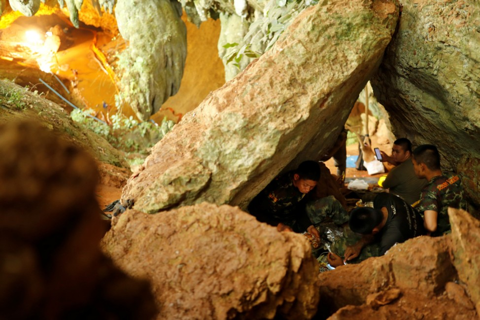 Rescue workers rest inside Tham Luang cave complex in the northern province of Chiang Rai