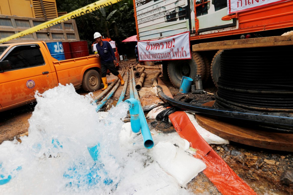 Water are pumped out from Tham Luang cave complex in the northern province of Chiang Rai