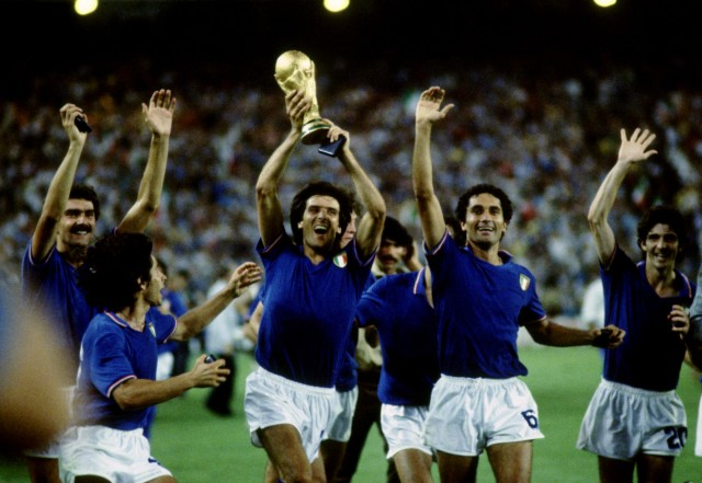 FILE PHOTO: Italy players celebrate and parade the World Cup trophy