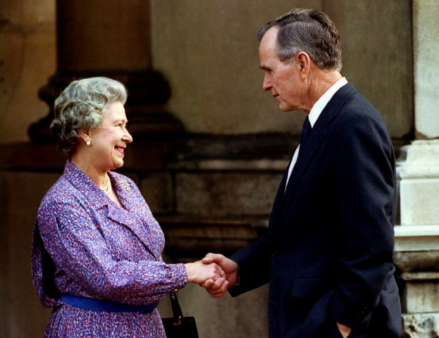 FILE PHOTO: Former U.S. President George Bush bids farewell to Britain's Queen Elizabeth at Buckingham Palace in London