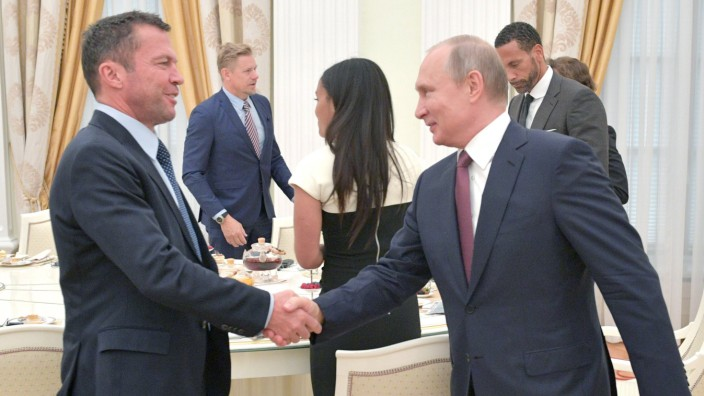 MOSCOW RUSSIA - JULY 6 2018 Former German footballer Lothar Matthaus L shakes hands with Russi