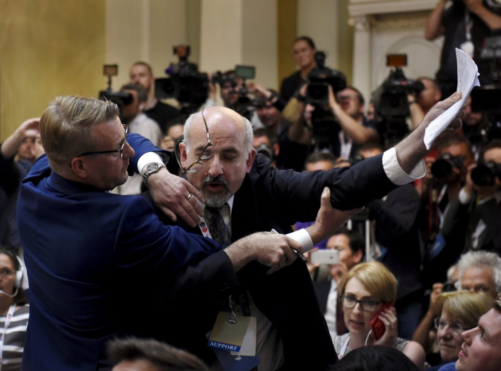 Security removes man holding sign before Putin-Trump joint press conference in Helsinki