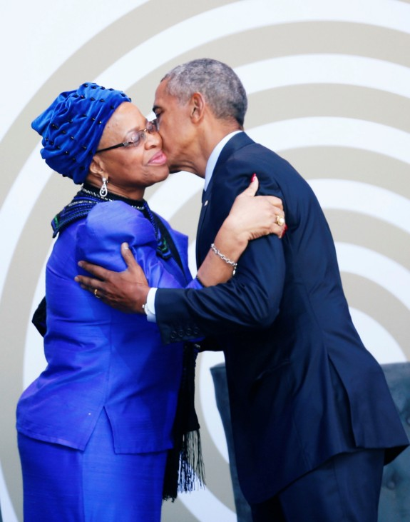 Former U.S. President Barack Obama greets Nelson Mandela's widow Graca Machel as he arrives to deliver the 16th Nelson Mandela annual lecture in Johannesburg