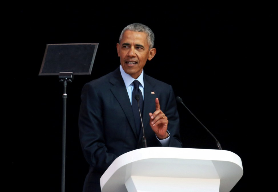 Former U.S. President Barack Obama delivers the 16th Nelson Mandela annual lecture, marking the centenary of the anti-apartheid leader's birth, in Johannesburg