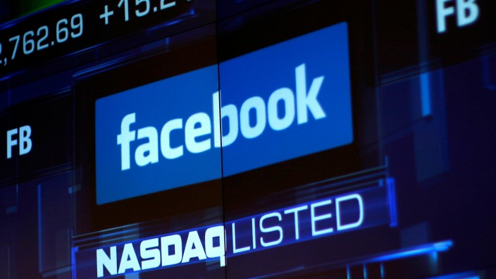FILE PHOTO: Monitors displays the Facebook, Inc. stock during morning trading at the NASDAQ Marketsite in New York