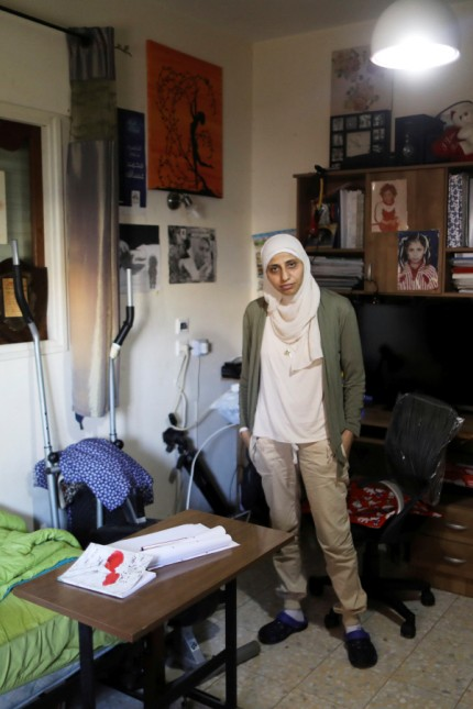 FILE PHOTO: Arab-Israeli poet Dareen Tatour, 35, poses for a picture during an interview with Reuters at her house in Reineh