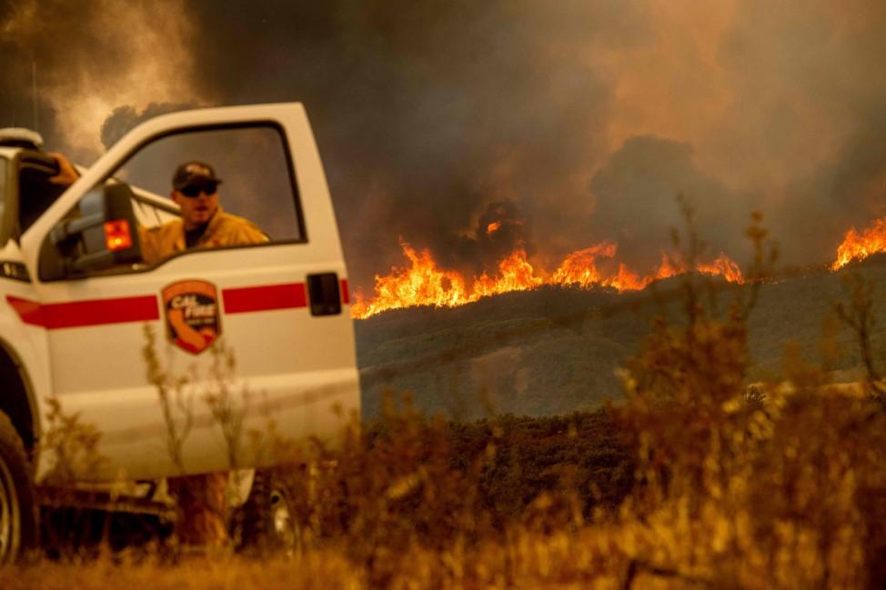 California battles raging wildfires