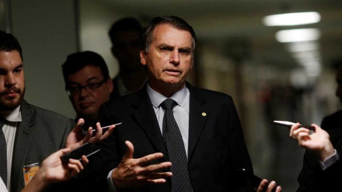 Bolsonaro, a presidential candidate for the PSL, is seen at the National Congress in Brasilia