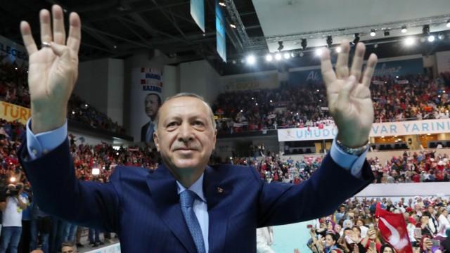 Turkish President Erdogan greets members of his ruling AK Party during a meeting in Ankara