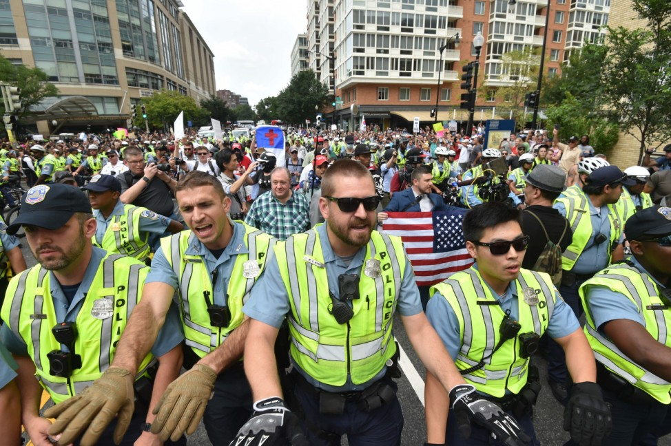 Far-right groups stage a rally near the White House, one year after deadly violence at a similar protest in Charlottesville, Virginia