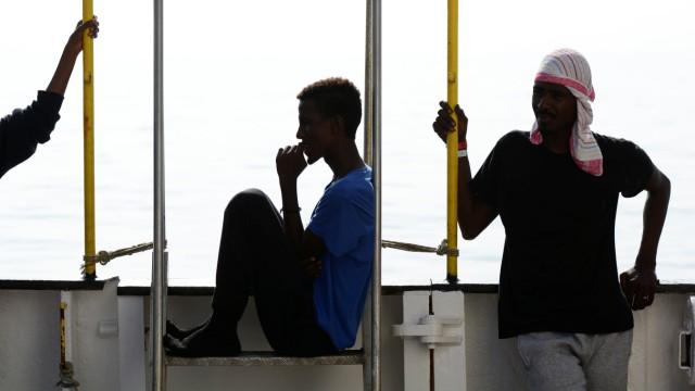 Migrants are seen resting on board the MV Aquarius rescue ship