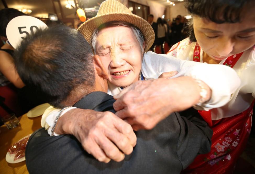 North and South Korean family members meet during a reunion at North Korea's Mount Kumgang resort