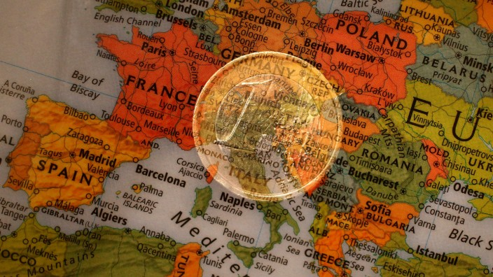 FILE PHOTO: A picture illustration taken with the multiple exposure function of the camera shows a one Euro coin and a map of Europe