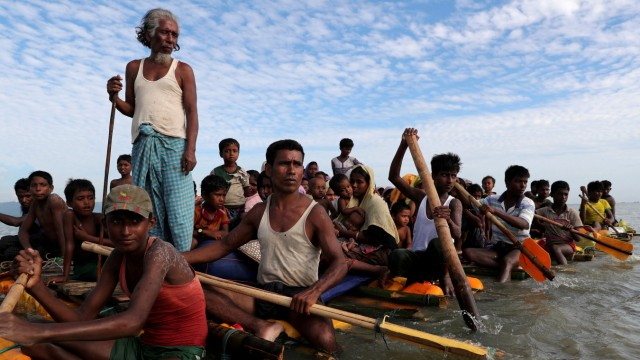 FILE PHOTO: Rohingya refugees cross the Naf River with an improvised raft to reach to Bangladesh in Teknaf