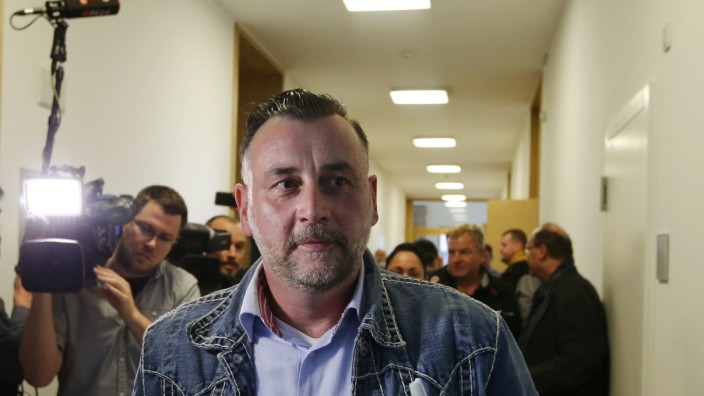 Bachmann, co-founder of PEGIDA, leaves during a break in his trial in a court in Dresden