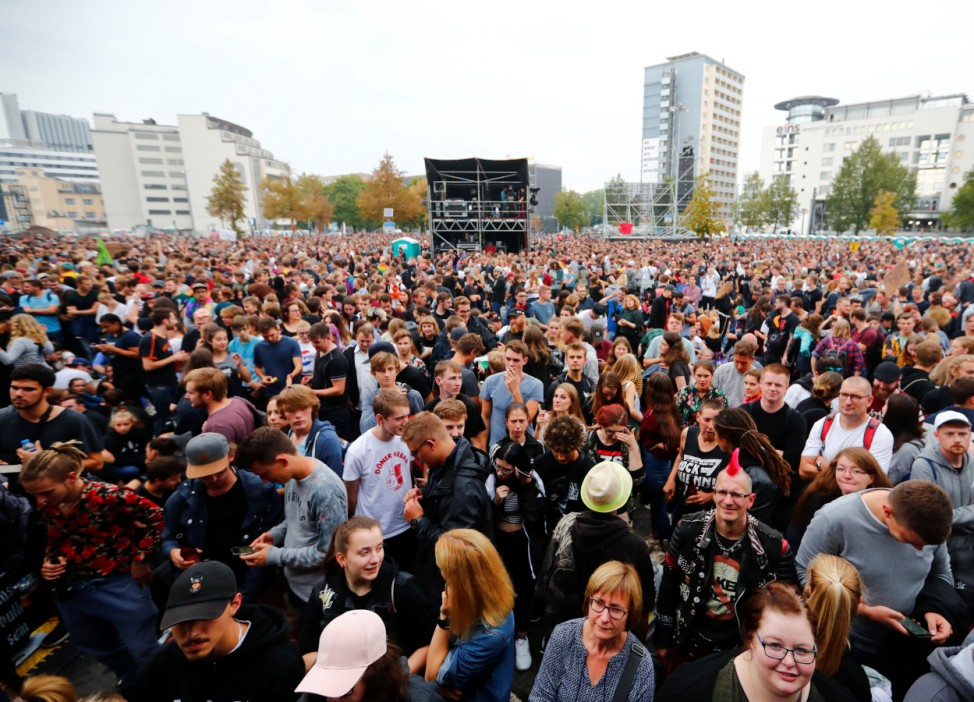 People gather before an open air 'anti-racism concert' in Chemnitz