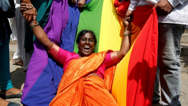 An activist of lesbian, gay, bisexual and transgender (LGBT) community celebrates after the Supreme Court's verdict of decriminalizing gay sex and revocation of the Section 377 law, in Bengaluru