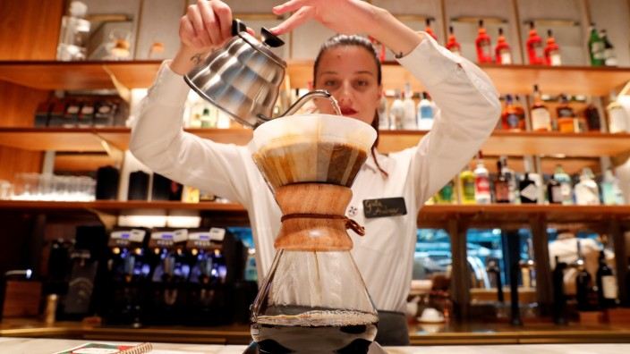 An employee prepares a coffee inside the new Starbucks Reserve Roastery flagship in downtown Milan