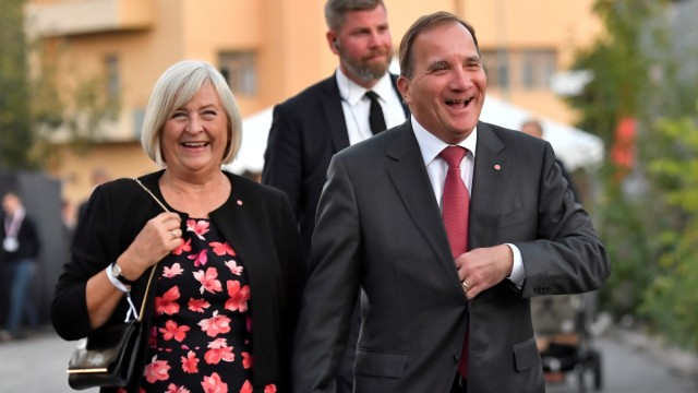 Swedish Prime Minister Stefan Lofven and his wife Ulla Lofven arrive at the Social Democratic Party's election wake in Stockholm