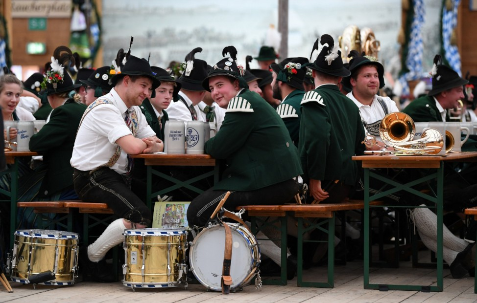 Participants from the Oktoberfest parade are seen in a tent during Oktoberfest in Munich