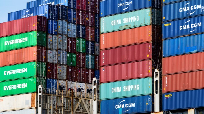 Shipping containers are stacked up at the port of Rotterdam