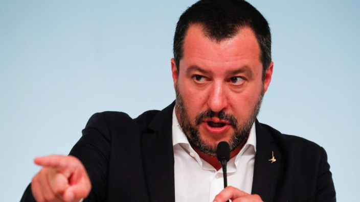 FILE PHOTO: Italy's Interior Minister Matteo Salvini gestures during a news conference with Prime Minister Giuseppe Conte after to approve a new decree of the measures on immigration and security at Chigi Palace in Rome