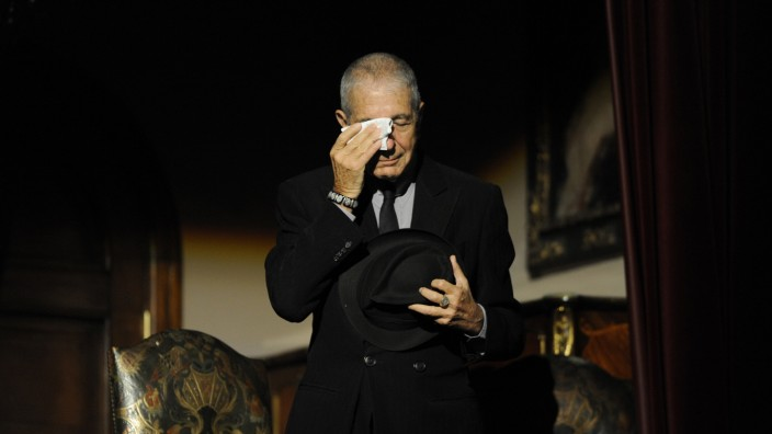 Canadian singer-songwriter Leonard Cohen cries during a tribute in Gijon