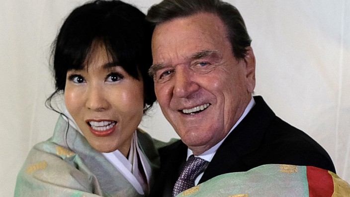 Former German Chancellor Gerhard Schroeder and his wife Kim So-yeon before their wedding party in Berlin