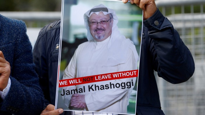 FILE PHOTO: A demonstrator holds picture of Saudi journalist Jamal Khashoggi during a protest in front of Saudi Arabia's consulate in Istanbul