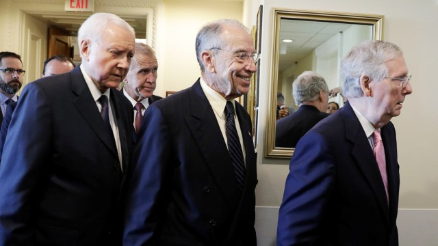 Senators Hatch, Tillis and Grassley arrive with Majority Leader McConnell to discuss FBI investigation into Kavanaugh assault allegations on Capitol Hill in Washington