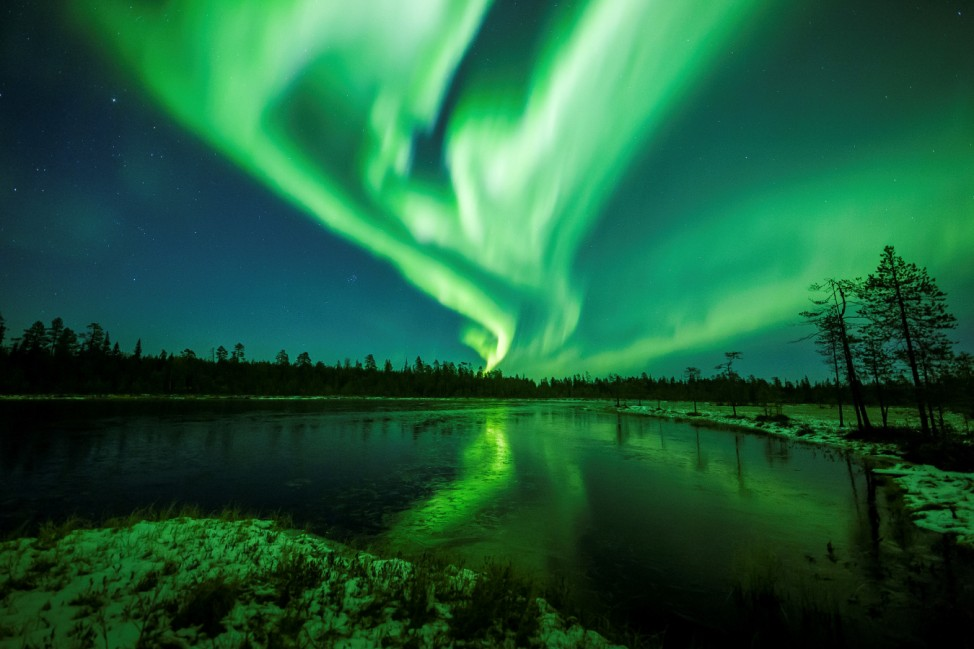 Aurora Borealis is seen over the sky near Rovaniemi in Lapland