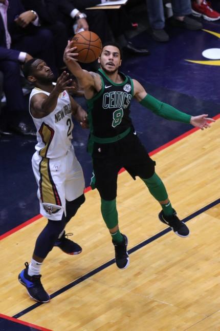 NEW ORLEANS LA MARCH 18 Boston Celtics guard Shane Larkin 8 secure aa rebound against New Orle
