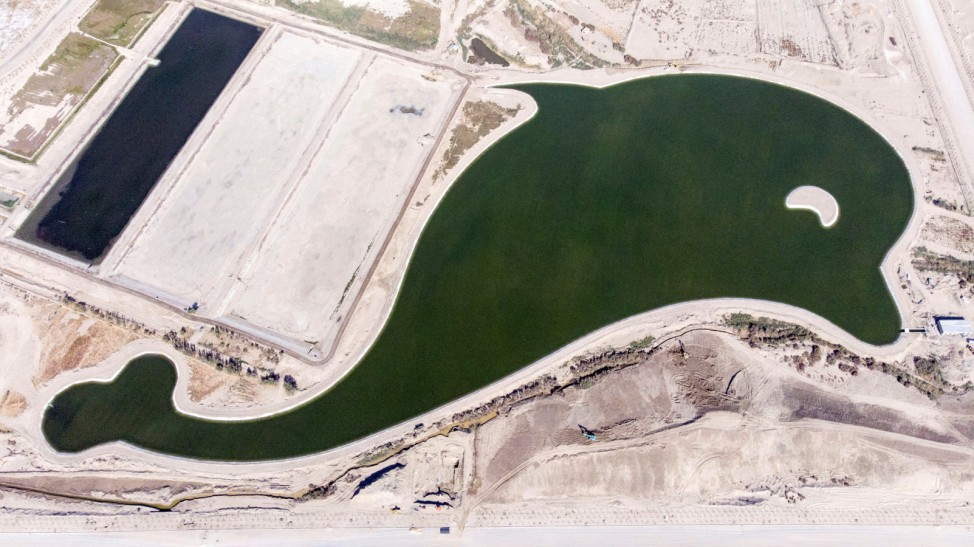 An aerial view shows a dolphin-shaped reservoir for wastewater treatment in Lopnur county, Bayingolin Mongol Autonomous Prefecture, Xinjiang