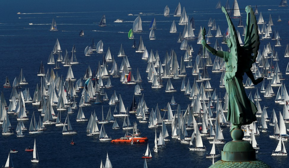 Sailboats gather at the start of the Barcolana regatta at Trieste harbour